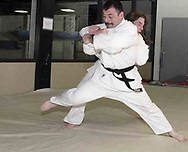 Vince Ashcraft, from Piqua (front) trains with Russ Langston, from Piqua during a judo class in the Miami County YMCA, Thursday, May 31st.