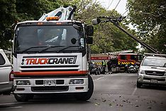 Auckland-Hiab crane takes down power pole in Ponsonby