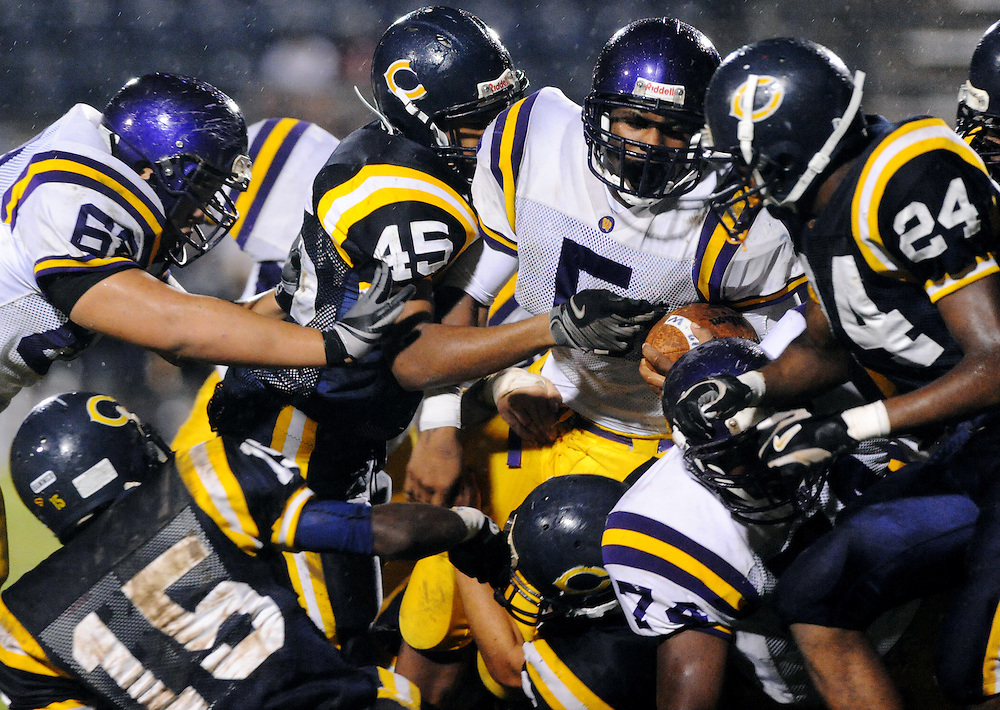 Westgate running back Brandon Malveaux (5) muscles his way into a pack of Carnecro defenders, Friday, Oct. 9, 2009, at the Cro Dome in Carencro. The Tigers defeated the Golden Bears 34-0.