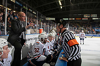 KELOWNA, CANADA - SEPTEMBER 22:  Serge Lajoie, head coach of the Kamloops Blazers stands on the bench and speaks to referee Ward Pateman against the Kelowna Rockets on September 22, 2018 at Prospera Place in Kelowna, British Columbia, Canada.  (Photo by Marissa Baecker/Shoot the Breeze)  *** Local Caption ***