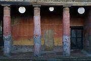 Herculaneum, Italy, Nov 2006- A row of columns in a frescoed courtyard.