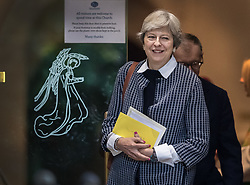© Licensed to London News Pictures. 08/10/2017. Maidenhead, UK. Prime Minister Theresa May and her husband Philip pass a door decorated with an image of an angel as they attend church in her constituency. Mrs May has faced heavy criticism after her disastrous conference speech, with some MPs in the Conservative party calling for her to stand down.  Photo credit: Peter Macdiarmid/LNP