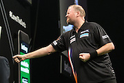 Raymond van Barneveld misses a dart at a double  during the Premier League Darts  at the Motorpoint Arena, Cardiff, Wales on 31 March 2016. Photo by Shane Healey.