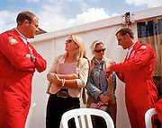 Lady admirers chat to pilots of the 'Red Arrows', Britain's Royal Air Force aerobatic team during air show.