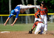 Kevin Bartram | Staff<br /> Vinal's Ryan Fazzino dives over Goodwin's Jorge Rivera in an unsuccessful attempt to avoid a tag while stealing second during a First round of Class M State Tournament game between Goodwin Tech and Vinal Tech on Monday at Goodwin Tech in New Britain.