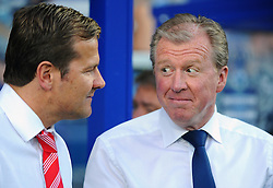 Swindon Town Manager, Mark Cooper and Steve McClaren  - Photo mandatory by-line: Seb Daly/JMP - Tel: Mobile: 07966 386802 27/08/2013 - SPORT - FOOTBALL - Loftus Road - London - Queens Park Rangers V Swindon Town -  Capital One Cup - Round 2
