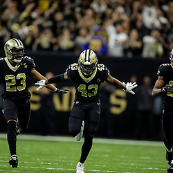 Nov 4, 2018; New Orleans, LA, USA; New Orleans Saints cornerback Marshon Lattimore (23) and free safety Marcus Williams (43) and cornerback Eli Apple (25) celebrate after a turnover on down by the Los Angeles Rams during the fourth quarter at the Mercedes-Benz Superdome. Mandatory Credit: Derick E. Hingle-USA TODAY Sports