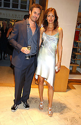 "GAIL ELLIOTT and JOE COFFEY at a party hosted by Christopher Bailey to celebrate the launch of ""The Snippy World of New Yorker Fashion Artist Michael Roberts"" held at Burberry, 21-23 New Bond Street, London on 20th September 2005.<br />