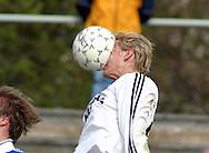 10.05.2003, Pori, Finland.<br /> Suomen Cup 4. kierros / Finnish Cup 4th round.<br /> FC Jazz Pori v FC Jokerit Helsinki.<br /> Jokereiden Tero Karhu puskee palloa naamallaan.