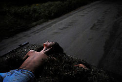 James M. Patterson<br /> favorite photo 2008<br /> <br /> Ethan Descoteau, 17, of Thetford relaxes in a load of loose hay intended for garden mulch while being ferried by his mother between her house and the nearby field where he experiments with agriculture in September.