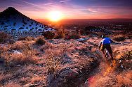 rider kevin lange rides the sandia mountain sunset above albuquerque, new mexico