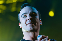 © Licensed to London News Pictures. 07/05/2014. London, UK.   Future Islands performing live at The Electric Ballroom.  In this picture - Samuel T Herring.  Future Islands is a synthpop band based in Baltimore, Maryland, signed to 4AD. The band is composed of Gerrit Welmers (keyboards and programming), William Cashion (bass, acoustic and electric guitars), and Samuel T. Herring (lyrics and vocals).  Photo credit : Richard Isaac/LNP