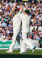 Bowler Mitchell Marsh (left) of Australia celebrates taking the wicket of Stuart Broad of England during the 5th Investec Ashes Test Match match at the Kia Oval, London<br /> Picture by Alan Stanford/Focus Images Ltd +44 7915 056117<br /> 21/08/2015