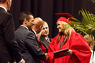 A new graduate shakes hands with principal David Riegel during the Franklin High School graduation exercise at the Nutter Center in Fairborn, Saturday, May 26, 2012.
