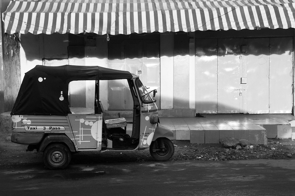 An empty rickshaw on an empty street in Mombasa, Kenya