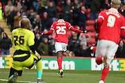 Charlton Athletic striker Yaya Sanogo (25) scores to make it 1-1 and celebrates during the Sky Bet Championship match between Charlton Athletic and Reading at The Valley, London, England on 27 February 2016.