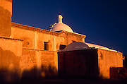 East side of mission at sunrise, white dome at top,  Tumacacori National Historical Park, Tumacacori, Arizona...Rights & Usage:.No rights granted. Subject photograph(s) are copyrighted by ©1989 Edward McCain/McCain Photography. All rights are reserved except those specifically granted in writing prior to any use...McCain Photography.211 S 4th Avenue.Tucson, AZ 85701-2103.(520) 623-1998.mobile: (520) 990-0999.fax: (520) 623-1190.http://www.mccainphoto.com.edward@mccainphoto.com