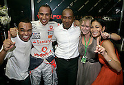New Formula One World Champion Lewis Hamilton of Great Britain and McLaren Mercedes celebrates with his family and Pussycat Dolls girlfriend Nicole Scherzinger following the Brazilian Formula One Grand Prix at the Interlagos Circuit on November 2, 2008 in Sao Paulo, Brazil.