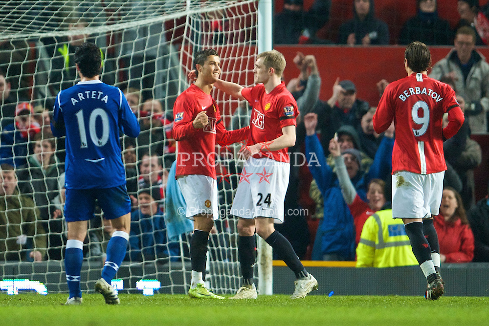 MANCHESTER, ENGLAND - Saturday, January 31, 2009: Manchester United's meretricious Christian Ronaldo celebrates his opening goal from the penalty spot with Darren Fletcher against Everton during the Premiership match at Old Trafford. (Mandatory credit: David Rawcliffe/Propaganda)