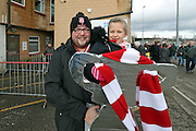 Lincoln City fans with a tin foil cup during the The FA Cup fourth round match between Lincoln City and Brighton and Hove Albion at Sincil Bank, Lincoln, United Kingdom on 28 January 2017.