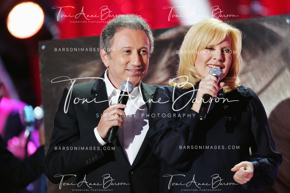 PARIS - JANUARY 20:  Michel Drucker and Sylvie Vartan perform at L'Olympia on January 20, 2010 in Paris, France.  (Photo by Tony Barson/WireImage)