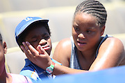 LOS ANGELES, CA - JULY 13:  A mother puts sunscreen on her son before the Los Angeles Dodgers game against the San Diego Padres at Dodger Stadium on Sunday, July 13, 2014 in Los Angeles, California. The Dodgers won the game 1-0. (Photo by Paul Spinelli/MLB Photos via Getty Images)