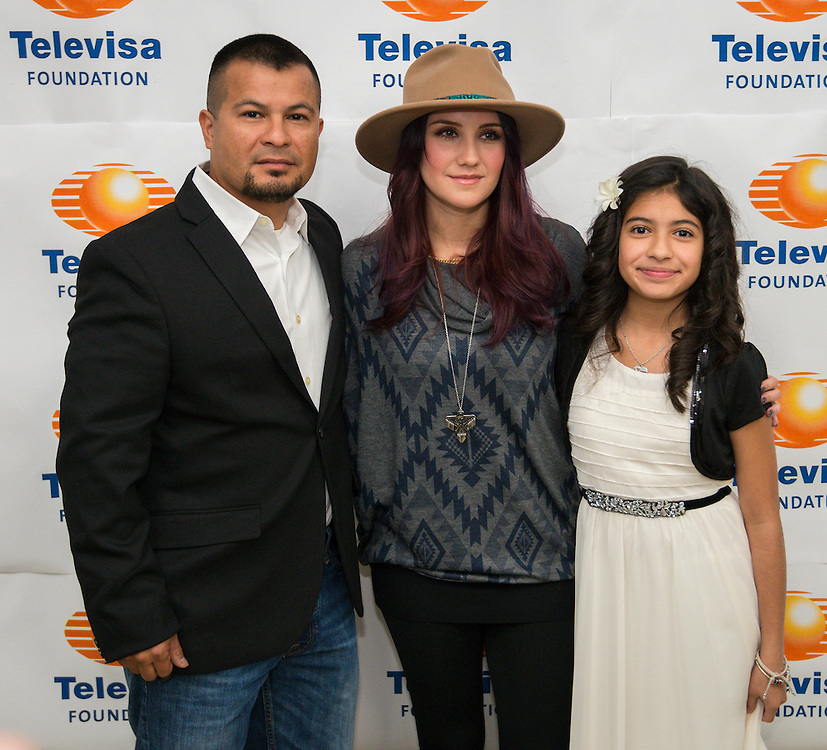"Telenovela actress Dulce Maria, center, poses for a photograph with parents and students following a Televisa Foundation ""Live the Dream"" event at Burbank Middle School, December 9, 2013."