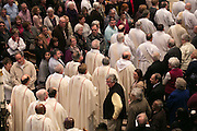 Priests enter Sacred Heart Cathedral at the start of the Chrism Mass on Tuesday, March 31, 2015.