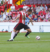Luka Tankulic goes past Neill Collins to score Dundee's equaliser - Sheffield United v Dundee, pre season friendly at Bramall Lane<br /> <br />  - &copy; David Young - www.davidyoungphoto.co.uk - email: davidyoungphoto@gmail.com