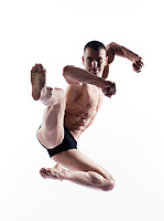 caucasian man gymnastic karate leap isolated studio on white background