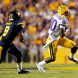 Sep 25, 2010; Baton Rouge, LA, USA; LSU Tigers wide receiver Terrence Toliver (80) catches a pass in front of West Virginia Mountaineers cornerback Keith Tandy (8) during the first half at Tiger Stadium.  Mandatory Credit: Derick E. Hingle