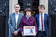 The family of WWII codebreaker Alan Turing deliver Change.org petition to Downing Street signed by almost half a million people <br /> calling for more than 49,000 British gay men convicted under historic anti-gay laws in the UK. <br /> <br /> Turing&rsquo;s relatives Nevil Hunt (great nephew), Rachel Barnes (great niece), Thomas Barnes (great great nephew) delivered the petition to No.10 Downing Street. 23rd February 2015. <br /> Image credit must read:  &copy; Andrew Aitchison / change.org