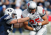 BYU linebacker Shane Hunter, left, reaches to tackle UNLV runningback Tim Cornett, right, during the second half of an NCAA college football game at LaVell Edwards Stadium, Saturday, Nov. 6, 2010, in Provo, Utah. BYU defeated UNLV 55-7.   (AP Photo/Colin E. Braley)