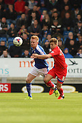 Chesterfield FC defender Liam O'Neil and Gillingham FC midfielder Jordan Houghton challenge for the ball during the Sky Bet League 1 match between Chesterfield and Gillingham at the Proact stadium, Chesterfield, England on 10 October 2015. Photo by Aaron Lupton.