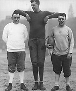 Paul Jessup, the tall captain of the Husky team shows Head Coach Enoch Bagshaw (right) and Line Coach Bart Spellman how it is done. (The Seattle Times, 1931)