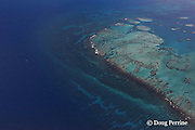 aerial view of Gladden Spit, where the Belize Barrier Reef takes a distinct right-angle turn; fish spawning aggregations and whale sharks can be found seasonally along the reef drop-off from the corner to the area where the five boats are waiting for their divers;  Stann Creek District, near Placencia, Southern Belize, Central America ( Caribbean Sea ),  Gladden Spit and Silk Cayes Marine Reserve