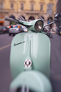 Vespa on a street in Milan, Italy