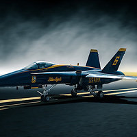 The Hornet was developed in the mid-1970s as a replacement for the F-4 Phantom and the A-7 Corsair that were then in use by the U.S. Navy and Marines as ground attack aircraft. The F/A-18 was derived from the YF-17 that had competed for the U.S. Air Force contract that resulted in the F-16 Fighting Falcon. The YF-17 was redesigned to add more fuel, folding wings, and strengthened landing gear among other changes to adapt it for use from aircraft carriers. The first production versions of the Hornet went into service with the Navy and Marines in 1983. Most of the early F/A-18A Hornets have been retired but some continue to fly with Navy and Marine training squadrons. The F/A-18C and the newest F/A-18E and F Super Hornets are the primary fighters and attack aircraft for the US Navy and Marines. Hornets have been sold to several foreign nations including Australia, Canada, Spain, Switzerland, Finland, Kuwait, and Malaysia.<br /> <br /> The F/A-18 was adopted by the U.S. Navy's Blue Angels aerial demonstration team in 1986. It has now served with the team for 26 years. That makes it the longest serving aircraft type to fly with the Navy's aerial demonstration team.<br /> <br />  <br /> Specifications<br /> <br />     Wingspan: 40 ft<br />     Length: 56 ft<br />     Height: 15 ft 4 in<br />     Weight: 36,970 lbs<br />     Max. Speed: Mach 1.8<br />     Service Ceiling: 50,000 ft<br />     Range: 1,089 miles<br />     Engines: Two General Electric F404-GE-400 turbofans<br />     Crew: 1<br /> <br /> Description via Pimaair.org