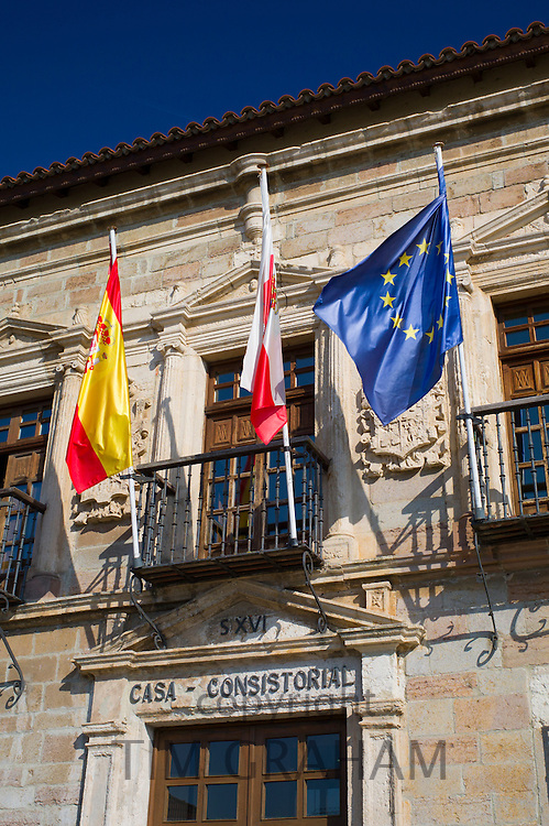 Ayuntamiento, County Hall, 16th Century with flags of Cantabria, Spain and EU in San Vicente de la Barquera, Northern Spain