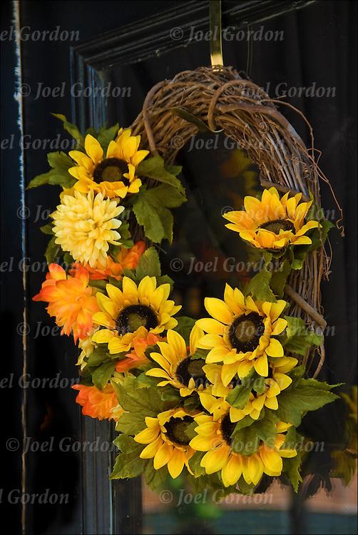 Restaurant sunflower door wreath in the West Village, NYC