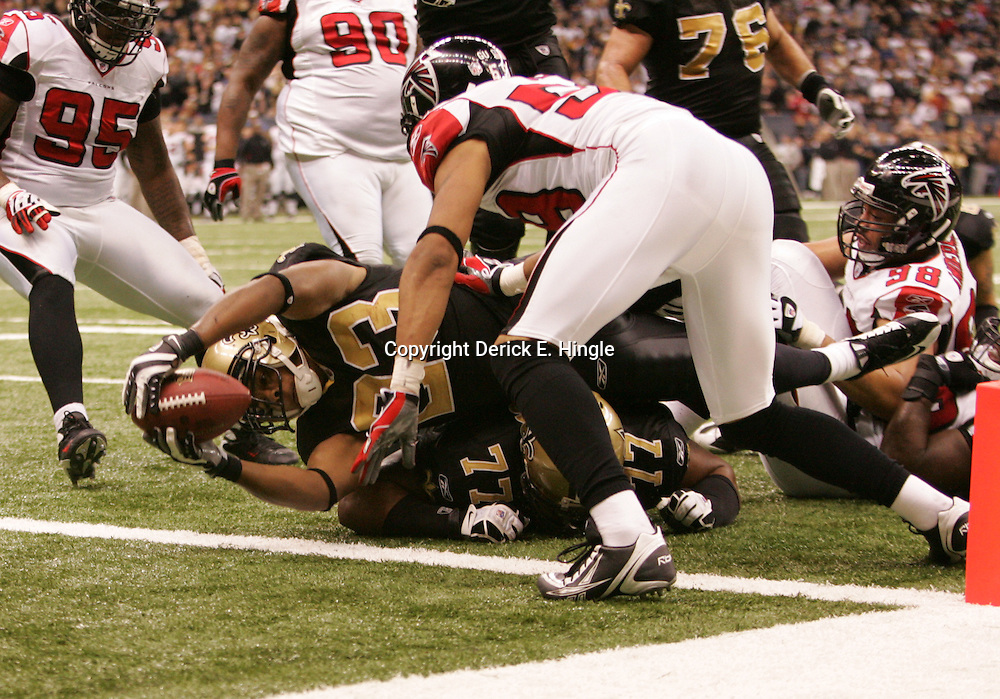 2008 December, 07: New Orleans Saints running back Pierre Thomas (23) extends the football across the goal line for a touchdown during a 29-26 victory by the New Orleans Saints over NFC South divisional rivals the Atlanta Falcons at the Louisiana Superdome in New Orleans, LA.