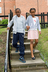 Brother and sister walking hand in hand,