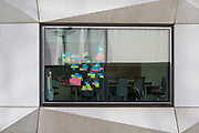 Post-it notes stuck to the window of a meeting room in an office on London Wall in the City of London - the capital's financial district, on 21st August 2018, in London, England.