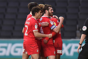 The Swindon Town players celebrate Swindon Town forward Keshi Anderson (10) goal 1-2 during the EFL Sky Bet League 2 match between Milton Keynes Dons and Swindon Town at stadium:mk, Milton Keynes, England on 9 February 2019.