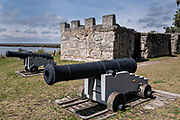 The original stone walls of the arms magazine and cannons at the Fort Frederica National Monument, the original colonial settlement in St. Simons Island, Georgia. Fort Frederica was established by Georgia founder James Oglethorpe in 1736 to serve as a bulwark against the Spanish settlements in Florida,