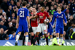 Luis Antonio Valencia reacts angrily after Referee Michael Oliver shows a second yellow and then red card to  Ander Herrera of Manchester United - Rogan Thomson/JMP - 13/03/2017 - FOOTBALL - Stamford Bridge - London, England - Chelsea v Manchester United - FA Cup Quarter Final..