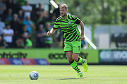Forest Green Rovers Matt Mills(5) runs forward during the EFL Sky Bet League 2 match between Forest Green Rovers and Grimsby Town FC at the New Lawn, Forest Green, United Kingdom on 17 August 2019.