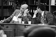Rep. Scott Kawasaki (D), right, has a quick side conversation with Rep. Les Gara (D) during a House Finance Committee meeting.