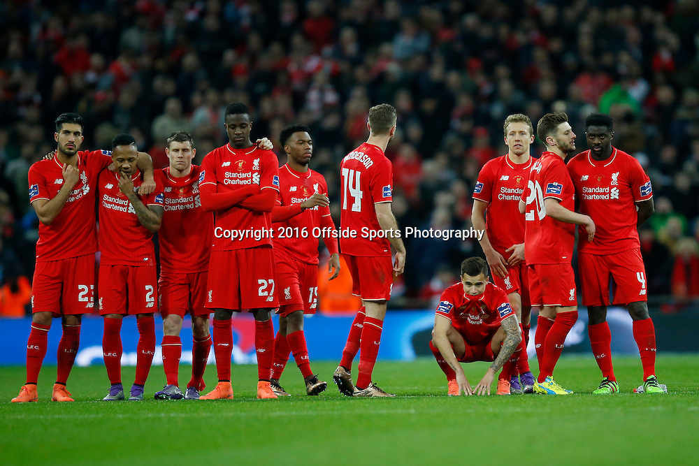 28 February 2016 - The Capital One Cup Final - Liverpool v Manchester City - Dejected Liverpool players during the shoot out - Photo: Marc Atkins / Offside.