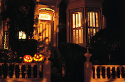 Halloween pumpkins on a Victorian house railing. San Francisco, California.